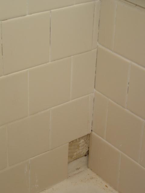 how to fix cracked grout in shower corner